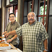 40 year counselor, serving Pizza to students at Event