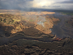 July 3, 2018 - Hawaii, U.S. - Evolution of a blocked channel. A blockage of rafted material within the lava channel causes lava to flow over its banks near the Kapoho cone. In this section of the lava channel a cold lava flow from the 1960 eruption forms a barrier on the north side, which initially directed the channel to the southeast. A constriction in the channel formed at the bend where chunks of cooled rafted lava were able to accumulate and block the flow. (Credit Image: © USGS/ZUMA Wire/ZUMAPRESS.com)