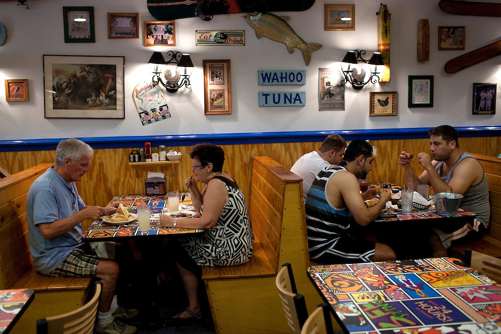 Long Beach Island, NJ - June 29, 2013 :  Tony McDonnell and Phyllis McDonnell from New City, NY, have lunch at The Chicken Or The Egg, open 24hrs, on Long Beach Island, NJ on June 29, 2013. People are returning to the beaches for the summer after recovery efforts post Superstorm Sandy.