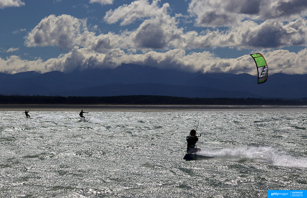 Kitesurfers in action at Tahunanui Beach, Nelson, South Island, New Zealand.. Home to Kitesurf Nelson, Tahunanui, the main beach in Nelson, is a great spot for all level of riders, with a consistent sea breeze that provides solid riding through the spring and summer season..The Nelson and Tasman region offer some great riding at some of the most scenic locations in New Zealand. .Tahunanui Beach, Nelson, South Island, New Zealand 31st January 2011. Photo Tim Clayton.