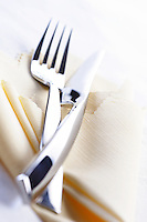 Close up of fork and knife lies on cloth