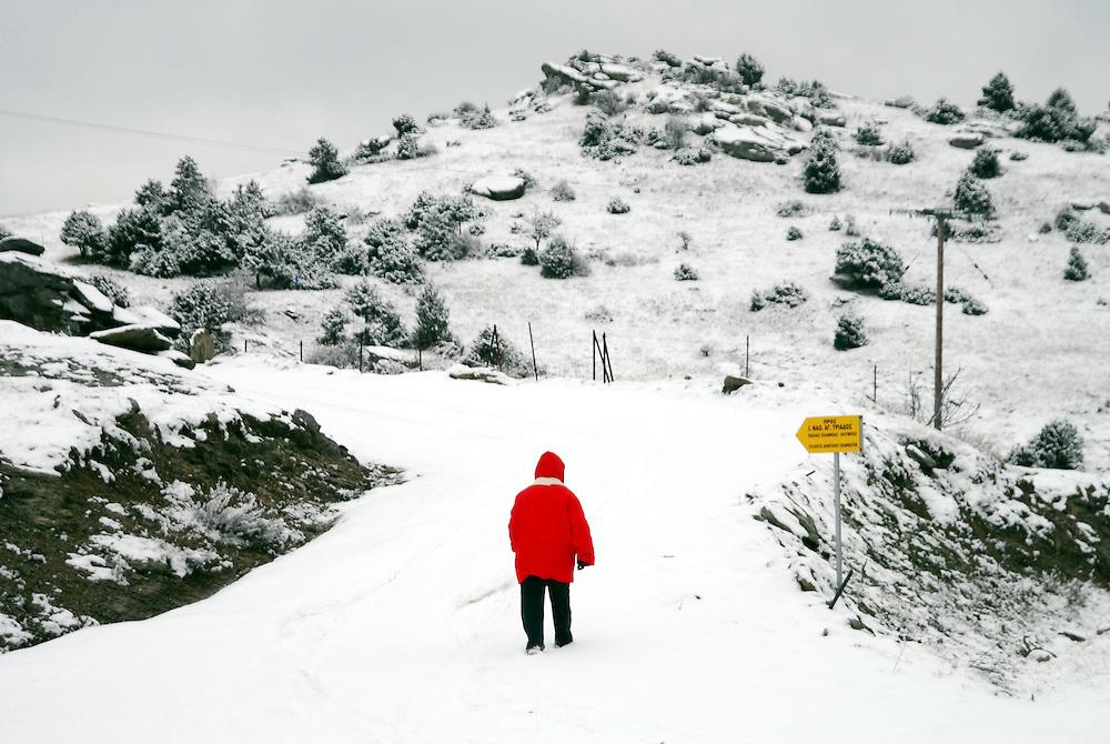 A snowy footpath on Olympus mountain. Kryovrisi village,  Thessaly region, northern Greece.