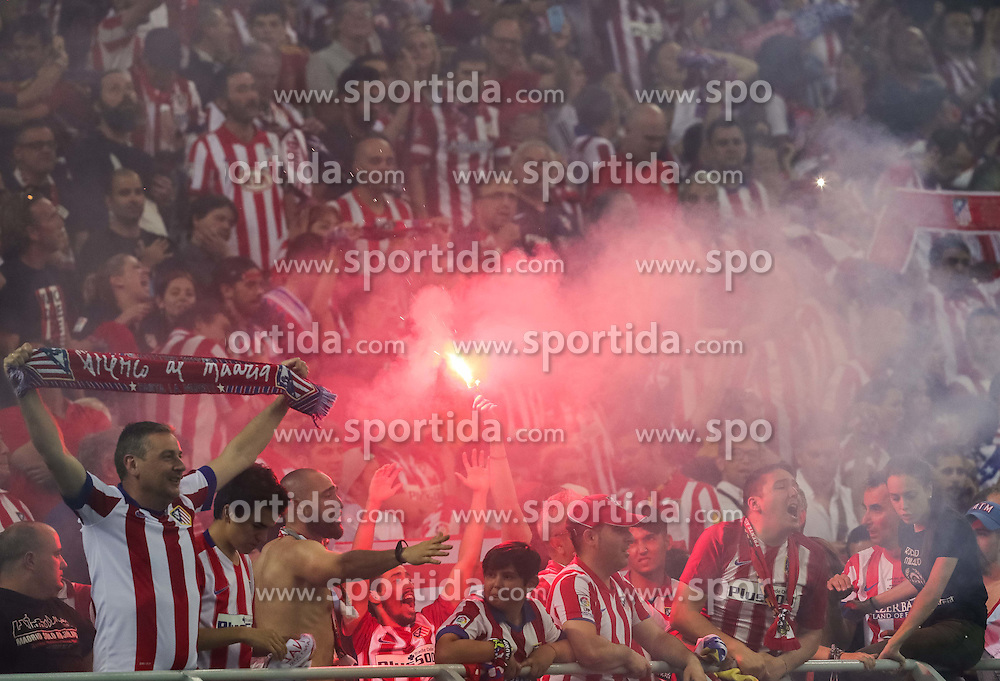 Supporters of Atletico celebrate after scoring first goal for Atletico during football match between Real Madrid (ESP) and Atlético de Madrid (ESP) in Final of UEFA Champions League 2016, on May 28, 2016 in San Siro Stadium, Milan, Italy. Photo by Vid Ponikvar / Sportida