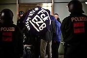 Frankfurt am Main | 09 Feb 2015<br /> <br /> Am Montag (09.02.2015) demonstrierte bereits zum dritten Mal die islamfeindliche und rassistische Gruppierung PEGIDA (Patrioden gegen die Islamisierung des Abendlandes) unter F&uuml;hrung der Frankfurterin Heidi Mund und in Gegenwart des Neonazis und Vorsitzenden der NPD Hessen, Stefan Jagsch, an der Katharinenkirche in Frankfurt am Main, PEGIDA konnte etwa 100 Demonstranten mobilisieren. An den Gegendemos nahmen etwa 1000 Menschen teil.<br /> Hier: Hessische Neonazis mit einem Regenschirm mit der Aufschrift &quot;FCK EZB - AKK Hessen&quot;.<br /> <br /> &copy;peter-juelich.com<br /> <br /> [No Model Release | No Property Release]