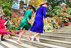 Princess Beatrice and her mother Sarah Ferguson arrives for the wedding of Princess Eugenie to Jack Brooksbank at St George's Chapel in Windsor Castle.