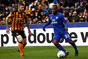 Cardiff City midfielder Junior Hoilett (33) attacking watched by Hull City defender Ondrej Mazuch (3) during the EFL Sky Bet Championship match between Hull City and Cardiff City at the KCOM Stadium, Kingston upon Hull, England on 28 April 2018. Picture by Mick Atkins.