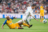 Real Madrid's Cristiano Ronaldo and Apoel's Carlos Roberto Da Cruz Junior during UEFA Champions League match between Real Madrid and Apoel at Santiago Bernabeu Stadium in Madrid, Spain September 13, 2017. (ALTERPHOTOS/Borja B.Hojas)
