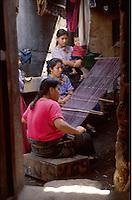 Women work on traditional weaving, Santiago Atitlan, Guatemala