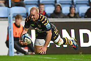 Wasps scrum half Dan Robson (9) dives over to score a try during the Gallagher Premiership Rugby match between Wasps and Bath Rugby at the Ricoh Arena, Coventry, England on 2 November 2019.