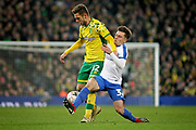 Norwich City forward Dennis Srbeny and Portsmouth midfielder Ben Thompson (32) during the The FA Cup 3rd round match between Norwich City and Portsmouth at Carrow Road, Norwich, England on 5 January 2019.