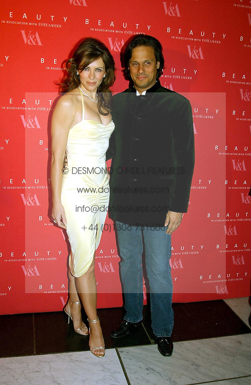 LIZ HURLEY wearing a Versace dress and Jimmy Choo shoes and ARUN NAYAR  at a party to launch 'Beauty Week' at the V&A in association with Estee Lauder- a special week of debates, talks and performances celebrating beauty on 24th January 2005.<br /><br />NON EXCLUSIVE - WORLD RIGHTS