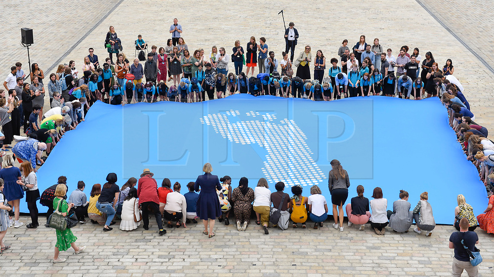 © Licensed to London News Pictures. 24/06/2019. LONDON, UK.  People take part in an opening event at Somersert House for Fly The Flag, a major new project marking the 70th anniversary of the Universal Declaration of Human Rights for which artist and activist Ai Weiwei has designed a new flag.  Photo credit: Stephen Chung/LNP