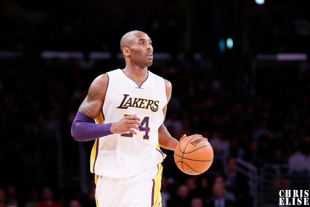 23 November 2014: Los Angeles Lakers guard Kobe Bryant (24) brings the ball up court during the Denver Nuggets 101-94 overtime victory over the Los Angeles Lakers, at the Staples Center, Los Angeles, California, USA.