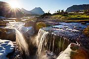MT00132-00...MONTANA - Early season waterfalls at Logan Pass in Glacier National Park.