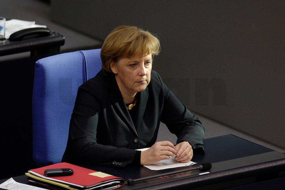 09 FEB 2006, BERLIN/GERMANY:<br /> Angela Merkel, CDU, Bundeskanzlerin, waehrend einer aktuelle Stunde zur Erhoehung des Renteneintrittsalters auf 67 Jahre, Plenum, Deutscher Bundestag<br /> IMAGE: 20060209-02-052