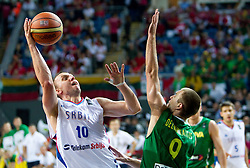 Dusko Savanovic of Serbia vs Tomas Delininkaitis of Lithuania during the third-place basketball match between National teams of Serbia and Lithuania at 2010 FIBA World Championships on September 12, 2010 at the Sinan Erdem Dome in Istanbul, Turkey. Lithuania defeated Serbia 99 - 88 and win placed third.  (Photo By Vid Ponikvar / Sportida.com)