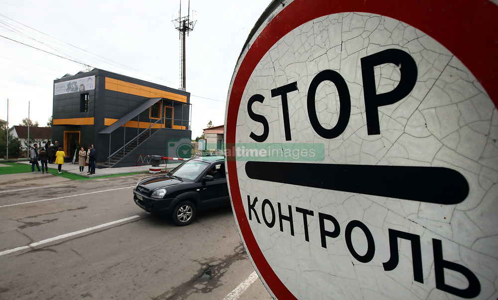 October 2, 2018 - Dytiatky Village, Kyiv Region, Ukraine - Cars are seen by an energy efficient information centre that was inaugurated at the Dytiatky checkpoint, the main gateway to the Chornobyl (Chernobyl) Exclusion Zone, Dytiatky village, Ivankiv district, Kyiv Region, northern Ukraine, October 2, 2018. Ukrinform. (Credit Image: © Tarasov/Ukrinform via ZUMA Wire)