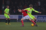 Swindon James Brophy (11) tackled by Peterborough Chris Forrester (8) 1-0 second half during the EFL Sky Bet League 1 match between Swindon Town and Peterborough United at the County Ground, Swindon, England on 21 January 2017. Photo by Gary Learmonth.