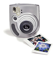 a polaroid instant film camera with 2 prints