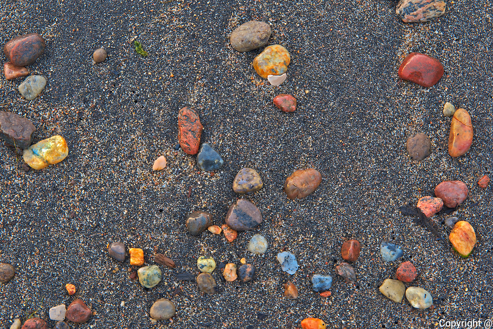 Pebbles on sandy beach at sunrise<br />Longue-Pointe-de-Mingan<br />Quebec<br />Canada