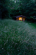 Buddhist on silent retreat in private cabin at the Rivendell Buddhist Retreat Centre, East Sussex, England.