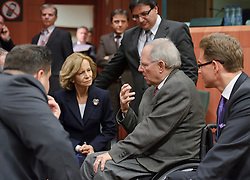 Wolfgang Schaeuble, Germany's finance minister, center right , speaks with Jan Kees De Jager, the Netherlands's finance minister, left, Elena Salgado, Spain's finance minister, center, Tonio Fenech, Malta's finance minister, standing center, and Jyrki Katainen, Finland's finance minister, right, during a meeting of the Eurogroup finance ministers at the EU Council headquarters in Brussels, Monday, Dec. 6, 2010. (Photo © Jock Fistick)