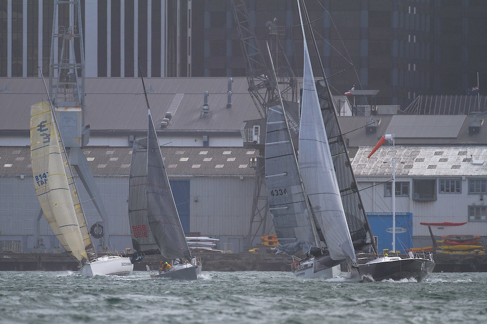 The fleet line up for the start on the Wellington waterfront at the Wellington restart of Round North Island two-handed yacht race. Wellington, New Zealand. 2 March 2011. Photo: Gareth Cooke/Subzero Images