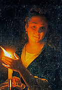 Woman with a Candle'  oil on canvas.Gotfried Schalcken (1643-1706) Dutch Baroque painter.  Young woman shelters the guttering flame with her hand.