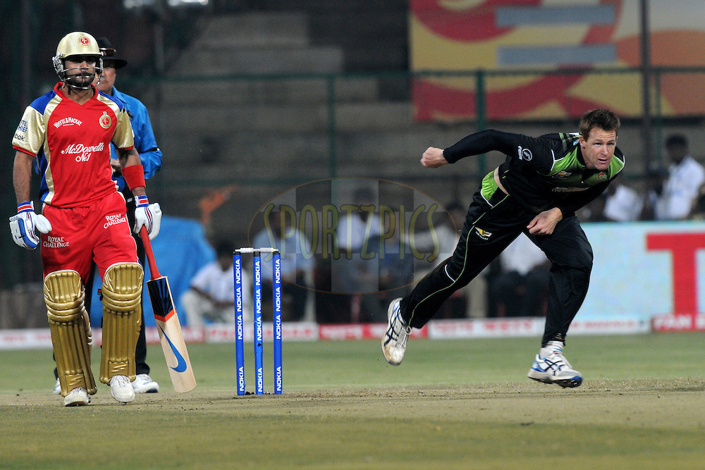 Rusty Theron of Warriors bowls during match 1 of the NOKIA Champions League T20 ( CLT20 )between the Royal Challengers Bangalore and the Warriors held at the  M.Chinnaswamy Stadium in Bangalore , Karnataka, India on the 23rd September 2011..Photo by Pal Pillai/BCCI/SPORTZPICS
