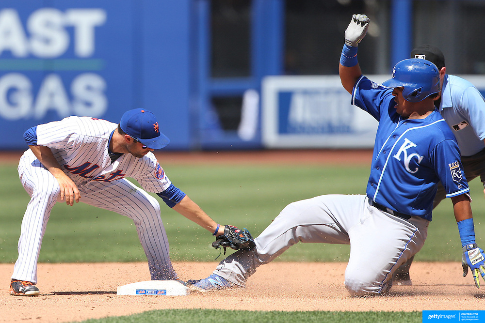NEW YORK, NEW YORK - June 22: Salvador Perez #13 of the Kansas City Royals is safe at second as Neil Walker #20 of the New York Mets applies the tag during the Kansas City Royals Vs New York Mets regular season MLB game at Citi Field on June 22, 2016 in New York City. (Photo by Tim Clayton/Corbis via Getty Images)
