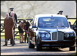 The Queen and The Duke of Edinburgh leave without receiving flowers from children after attending the Church service on the Sandringham estate, Sandringham, Norfolk, United Kingdom. Sunday, 29th December 2013. Picture by Andrew Parsons / i-Images