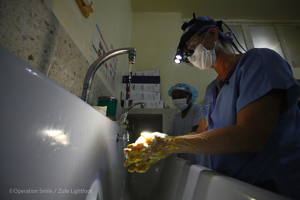 Plastic Surgeon Petra Peterson from Sweden with Plastic Surgeon - Observer's  Romain Raherison from Madagascar on the first day of surgery. Operations Smile's 2015 mission to Tamatave at Tamatave General Hospital. Antsirabe Clinic Project sponsored by the Swedish Postal Code lottery. Madagascar. September 2015.<br /> (Operation Smile Photographer &ndash; Zute Lightfoot)