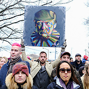 A man holds up a caricature of President Donald Trump during a Muslim Ban Protest in Nashville, TN on January 27, 2017