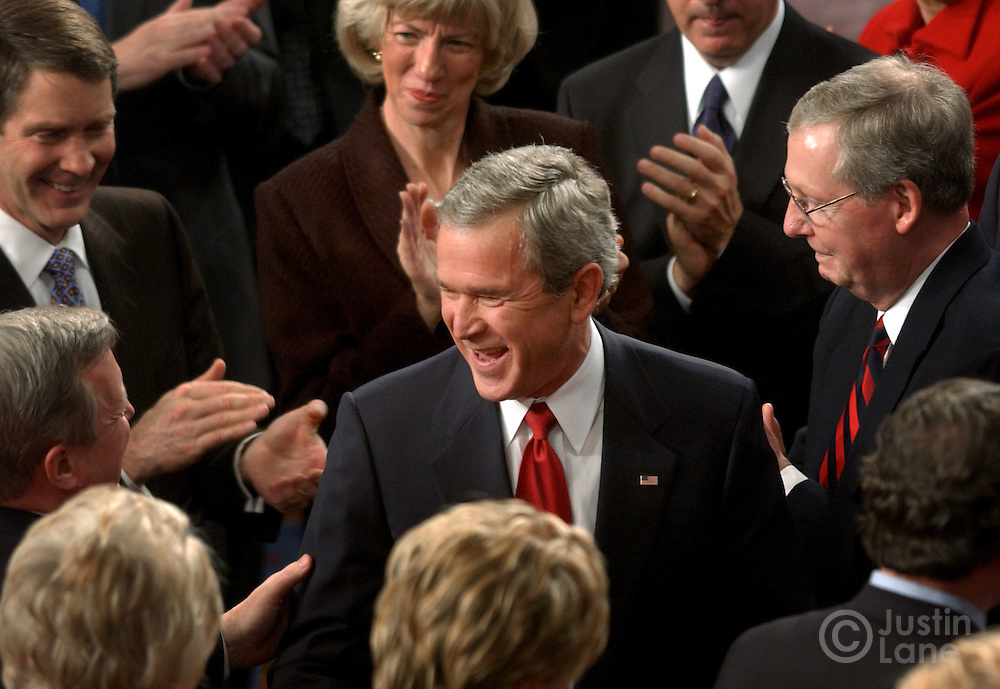 United States President George W. Bush smiles as he surrounded by members of Congress after delivering his 2005 State of the Union address in Washington, DC Wednesday 2 February 2005.