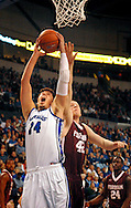 St. Louis  University basketball player Cody Ellis (24) is fouled by Fordham University's Ryan Canty (42) during the first half of the Billikens' 66-46 Atlantic 10 win over the Rams at Chaifetz Arena on the St. Louis University campus Saturday, Feb. 18, 2012 in St. Louis. Photo © copyright 2012 Sid Hastings.