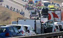 Stranded motorists survey the scene of the multi car pile up on the A249 Isle of Sheppey  bridge in Kent, Thursday, 5th September 2013. Picture by Stephen Lock / i-Images