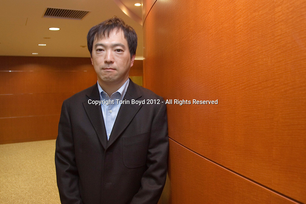 This is Masataka Horii, whose title is General Manager of the Fixed Income Management Department of Kokusai Asset Management Co., Ltd. of Tokyo. Mr. Horii was photographed on January 6, 2012 for an interview by Handelsblatt of Germany at his company's head office in Tokyo.