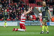 Doncaster Rovers Forward John Marquis (9) calls for foul in the penalty area during the EFL Sky Bet League 1 match between Doncaster Rovers and Bristol Rovers at the Keepmoat Stadium, Doncaster, England on 27 January 2018. Photo by Craig Zadoroznyj.