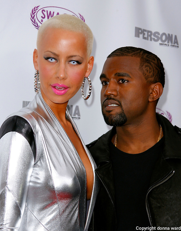 Amber Rose and Kanye West pose at the Persona Magazine Launch at Griffin in New York City on September 11, 2009. .