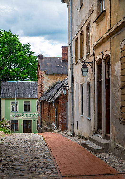 LATVIA, CESIS - CIRCA JUNE 2014: View of  typical cobblestone street in Cesis