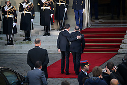 Outgoing Prime Minister Manuel Valls and his successor Bernard Cazeneuve, the outgoing Minister of the Interior arrive for a ceremony of transfer of power, at the Prime Minister's office Hotel de Matignon, in Paris, France on December 6, 2016. Valls has resigned to declare himself a candidate for the presidency, four days after President Francois Hollande announced he would not seek re-election next May 2017. Photo by Alain Robert/ABACAPRESS.COM
