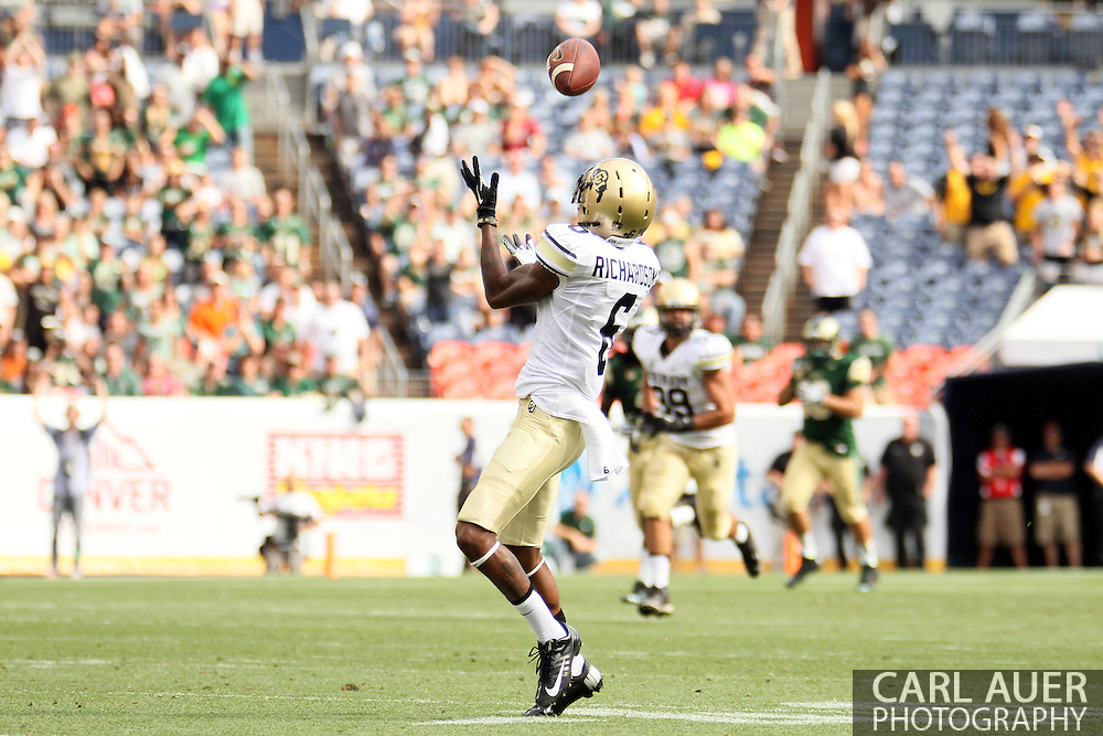 September 1st, 2013 - Colorado Buffaloes junior wide receiver Paul Richardson (6) finds himself wide open for a 82 yard touchdown reception in the first half of action in the NCAA football game between the Colorado Buffaloes and the Colorado State Rams at Sports Authority Field in Denver, CO