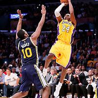 19 October 2014: Los Angeles Lakers guard Kobe Bryant (24) takes a jump shot over Utah Jazz guard Alec Burks (10) during the Los Angeles Lakers 98-91 victory over the Utah Jazz, in a preseason game, at the Staples Center, Los Angeles, California, USA.