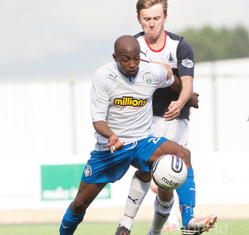 Morton's Fouad Bachirou and Falkirk's Thomas Grant.<br /> Falkirk 3 v 0 Morton, Scottish Championship 17/8/2013.<br /> &copy;Michael Schofield.