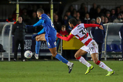 AFC Wimbledon defender Terell Thomas (6) dribbling past Doncaster Rovers attacker Kwame Thomas (39) during the EFL Sky Bet League 1 match between AFC Wimbledon and Doncaster Rovers at the Cherry Red Records Stadium, Kingston, England on 14 December 2019.