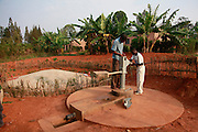 Water Aid Technician Pocienne Niyomukesha working on the pump at Ntarama Orphan Village.  Juru district. Bugesera district. Rwanda...© Zute Lightfoot / Water Aid