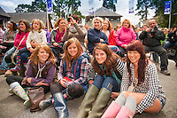Four young women wearing wellies<br /> Royal Welsh Show 2011<br /> Llanelwedd<br /> Powys<br /> Mid<br /> Events
