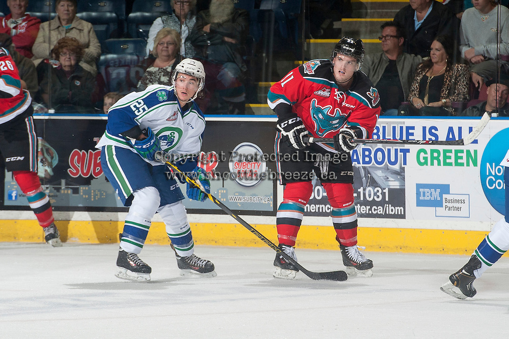 KELOWNA, CANADA - OCTOBER 7: Zac Mackay #25 of Swift Current Broncos checks Carter Rigby #11 of Kelowna Rockets after he passes the puck on October 7, 2014 at Prospera Place in Kelowna, British Columbia, Canada.  (Photo by Marissa Baecker/Getty Images)  *** Local Caption *** Carter Rigby; Zac Mackay;