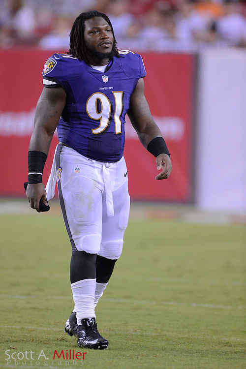 Baltimore Ravens outside linebacker Courtney Upshaw (91) with his helmet off during a preseason NFL game at Raymond James Stadium on Aug. 8, 2013 in Tampa, Florida. <br /> <br /> &copy;2013 Scott A. Miller