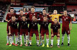 Latvia's (back, left to right) Antonijs Cernomordijs, Eduards Emsis, Roberts Uldrikis , Raivis Jurkovskis, Vladislavs Kurakins, Vladislavs Fjodorovs (front, left to right) Viktors Litvinskis, Ingars Stuglis, Kriss Karklins, Vladislavs Sorokins, Andrejs Ciganiks